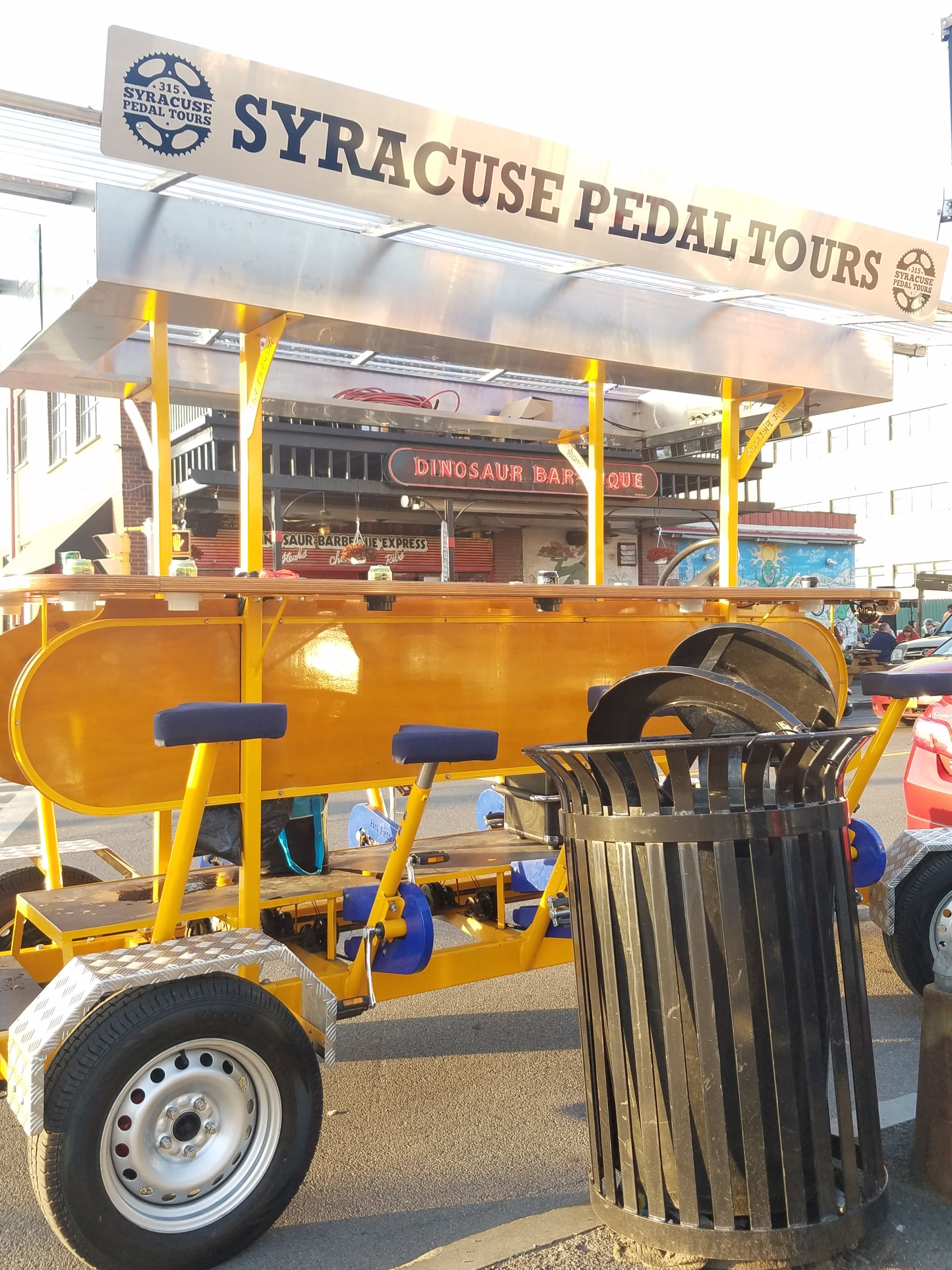 Syracuse Pedal Tours bike outside of Dinosaur Barbeque